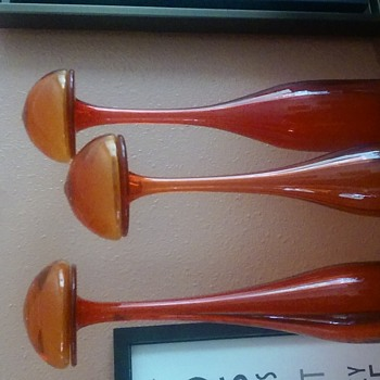 Hand blown orange glass decanters with mushroom tops. My recent find.