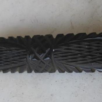 Carved black bakelite brooch