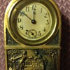 Small brass windup clock
