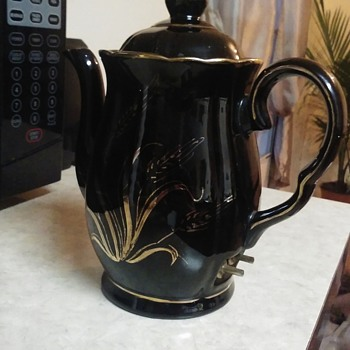 Teapot with prongs on the side