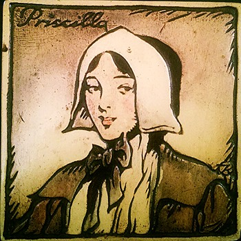 Art tile or wall hanging with Priscilla (Alden?) copyright 1929