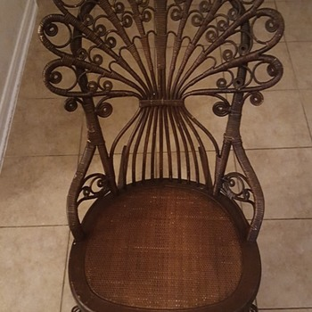 Ornate wicker rocker