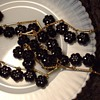 Trifari black cut glass bead bracelet & flapper necklace.