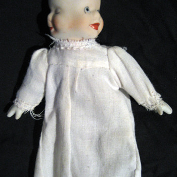 Three-Faced Doll with bisque head and hands