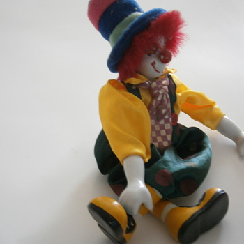 Porcelain sitting Dangling Clown Doll