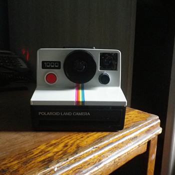 More Retro than retro let me introduce you too the Polaroid 1000 land camera with the rainbow strips and big red button. - Cameras