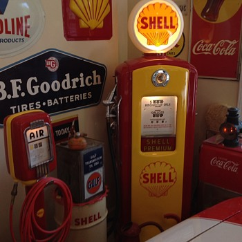 Old gas pumps and oil & gas signs along with a 1969 camaro. I've collected these over the years and love the hunt.  - Petroliana