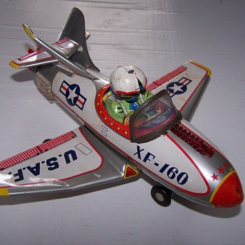 Old Tin Battery operated plane - Toys
