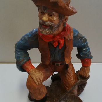 bronze look resin statue of a miner