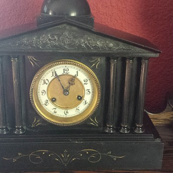 Need help identify and how to get this clock working family is anxious