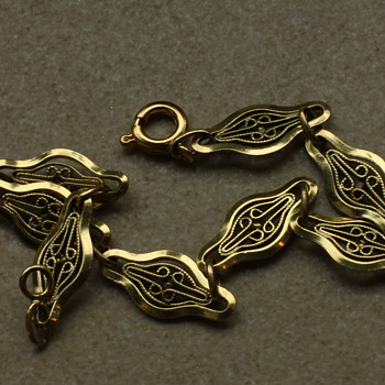 Gold colored filigree bracelet - Costume Jewelry