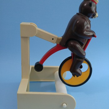 Bear on bicycle toilet paper holder - Animals