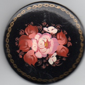 Paparmachie Pin Brooch richly decorated with a flowered centre and gold chain type decoration around rim, signed on rear.  - Folk Art