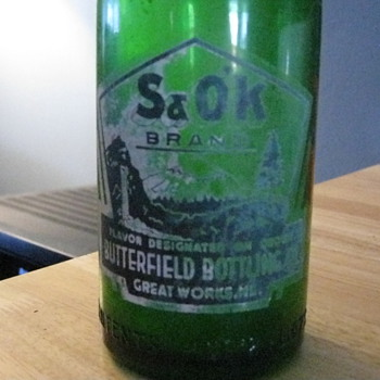 Green glass S&amp;O&#039;K brand bottle