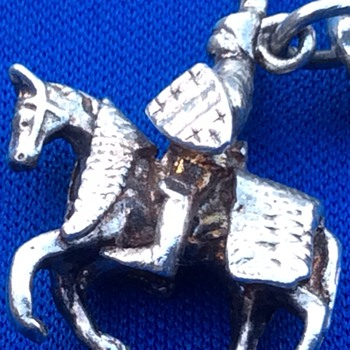 Antique silver charm