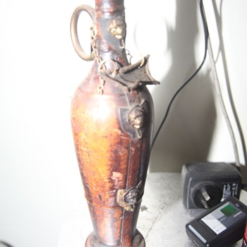 leather covered bottle with lions  - Bottles