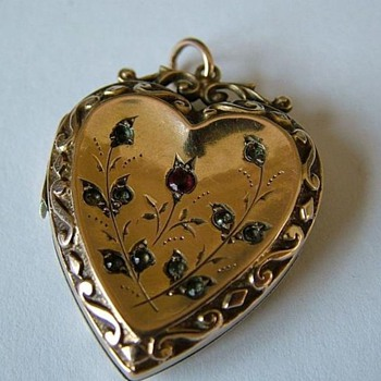 Victorian 9K locket / pendant with garnet and rose diamonds.