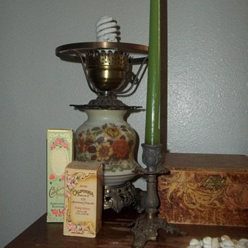 Antique Sewing Machine with Jewelry Boxes, Avon Cologne Bottles, and Lamp and Candlestick