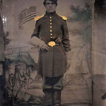 Tinted tintype of Civil War soldier with Colt pistol