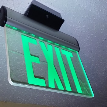 green lettered 'edgelit' EXIT sign