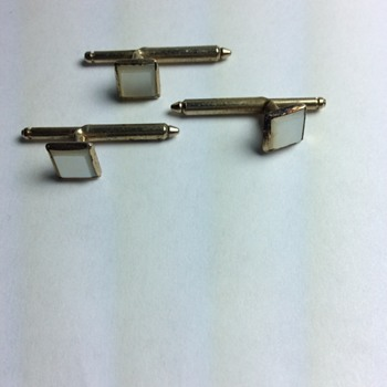 Some type of cufflink or buttonhole decoration?