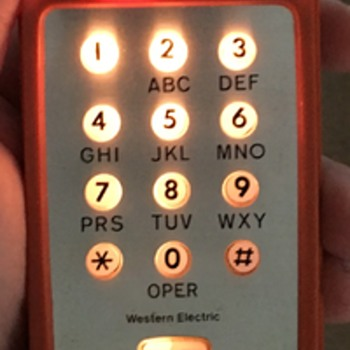 Western Electric orange trimline phone  - Telephones