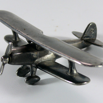 silver or silverplated biplane - Military and Wartime