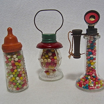 Vintage glass candy containers of the 1940s and 50s