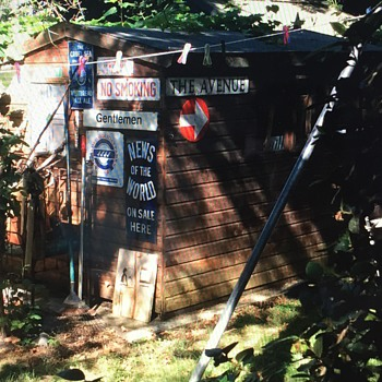 Shed with neat signs.