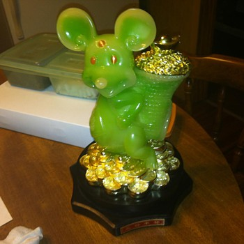 green Mickey mouse on pedestal - Animals