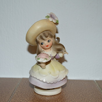 Little girl with a bouquet figurine