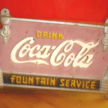 Help me identify this Coke sign