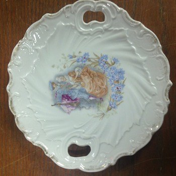 Handled porcelain plate, gilt edged, 1800s musician with lute