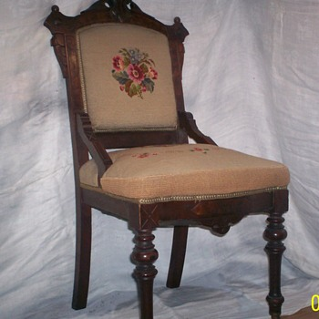 ornate chair with needlepoint back and seat