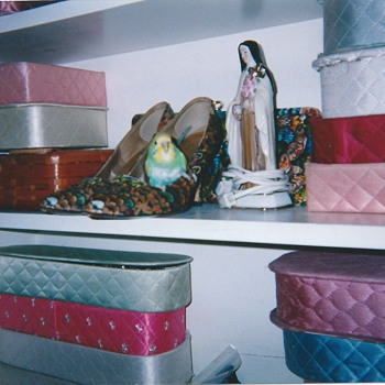 Valentino97 poses w/quilted boxes, shoes & St. Theresa.