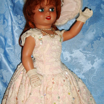 "20 "" hard plastic glancing eyes, swivel waist european ? 60's ? beautiful"