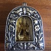silver locker with a buddha inside