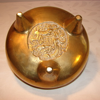 Asian brass footed bowl with dragon marks