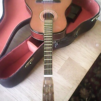 Adorable miniature six string salesman's guitar. Sample