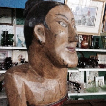 Carved wood  woman ? What's her nationality?