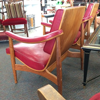 Bent wood and red naugahyde lounge chairs. Danish?