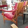 Bent wood and red naugahyde lounge chairs. Danish?