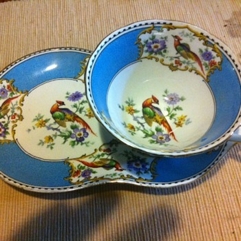 Tea cup and oddly shaped saucer - China and Dinnerware