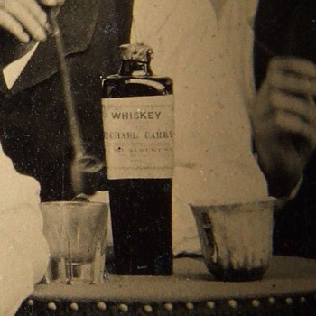 Occupational tintype with Whiskey Bottle