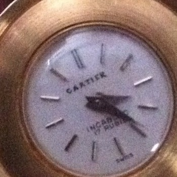 Need some help with this item.......anyone knows anything? I know its a Cartier watch....18k o750..!!!