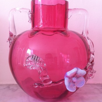 A cranberry urn with interestingly-shaped handles and applied flowers - Art Glass