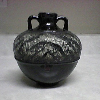 POTTERY VASE WITH A ZEBRA CUT GLASS DESIGN
