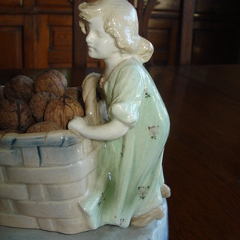 Majolica Art Nouveau girl with basket and baby with egg - Art Pottery