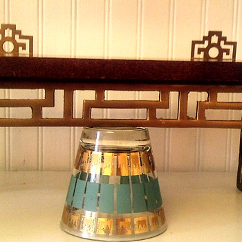 Asian influenced wood and brass shelves