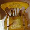 Antique Child's Rocking Chair with carved lion on back & caned seat